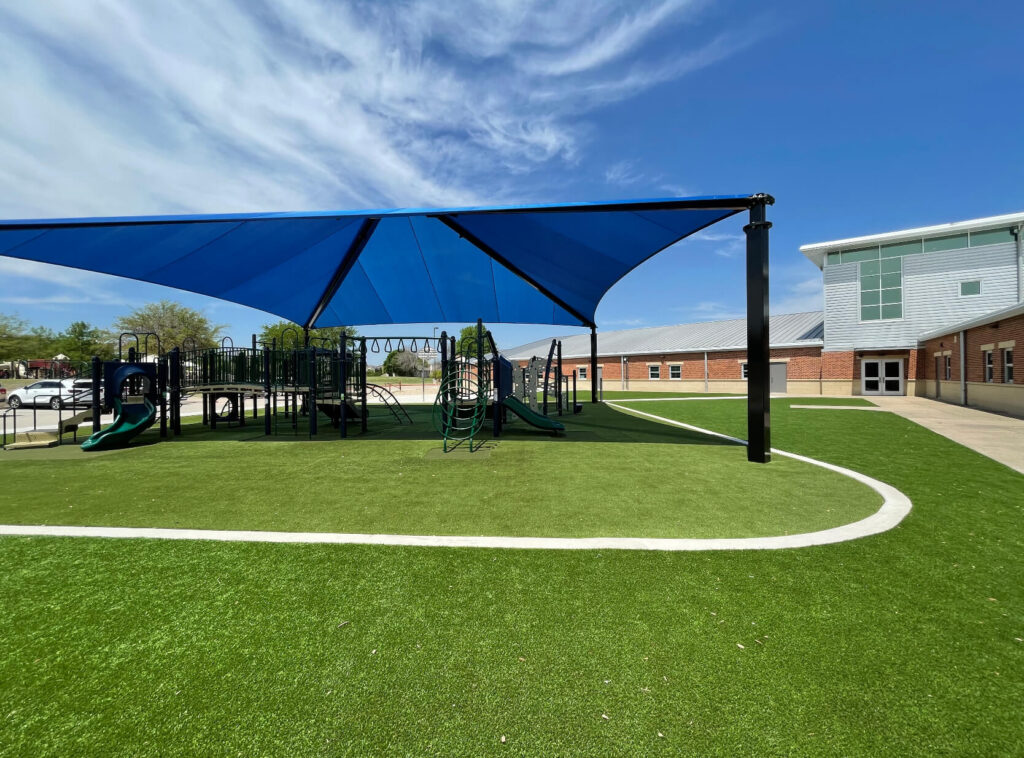 playground installed on artificial turf