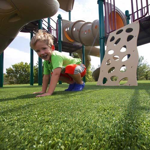 Boy Playing on SynLawn Playground