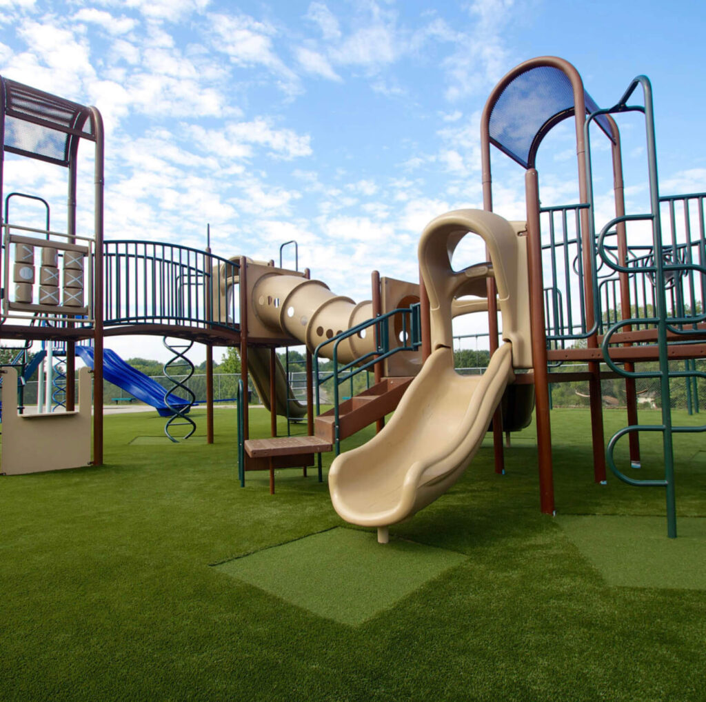playground with artificial turf installation
