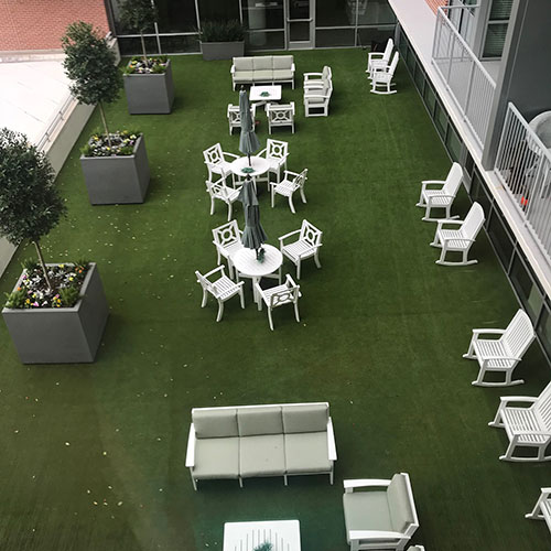 SynLawn Rooftop aerial view artificial turf with white chairs