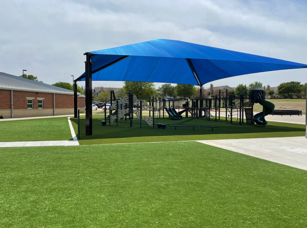 commercial artificial lawn installation on playground