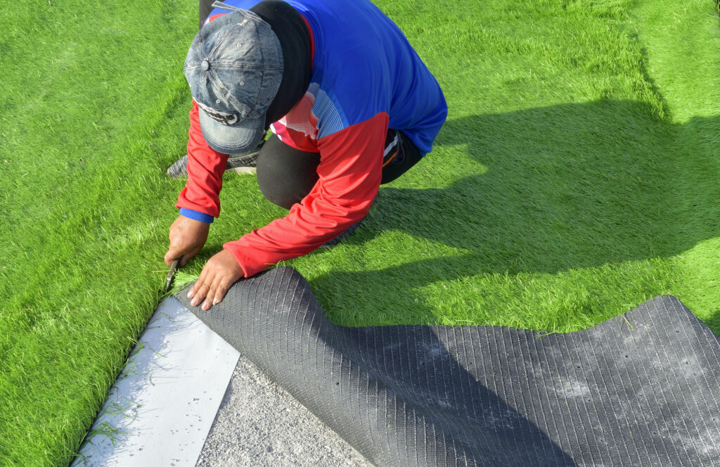 person installing turf