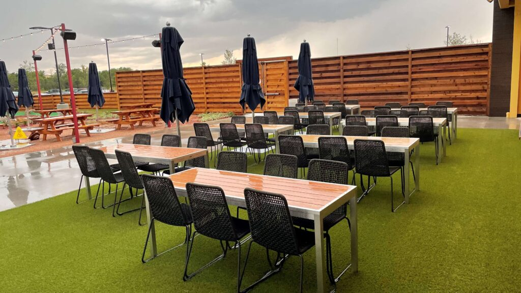 outdoor dining area on artificial turf