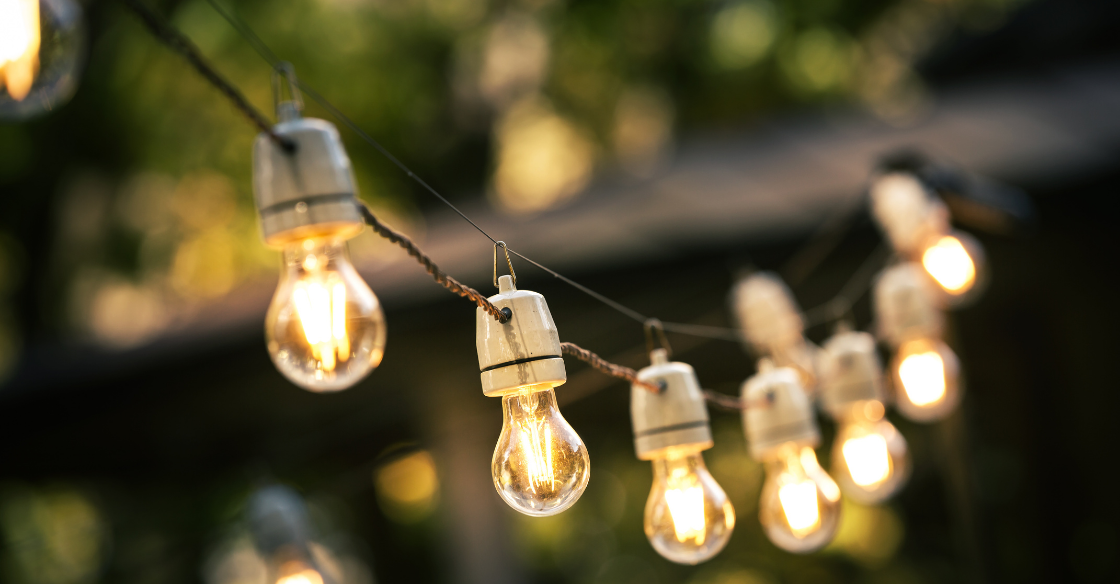 String lights are illuminated as part of a patio's design